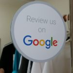 photo of a sticker requesting reviews on Google